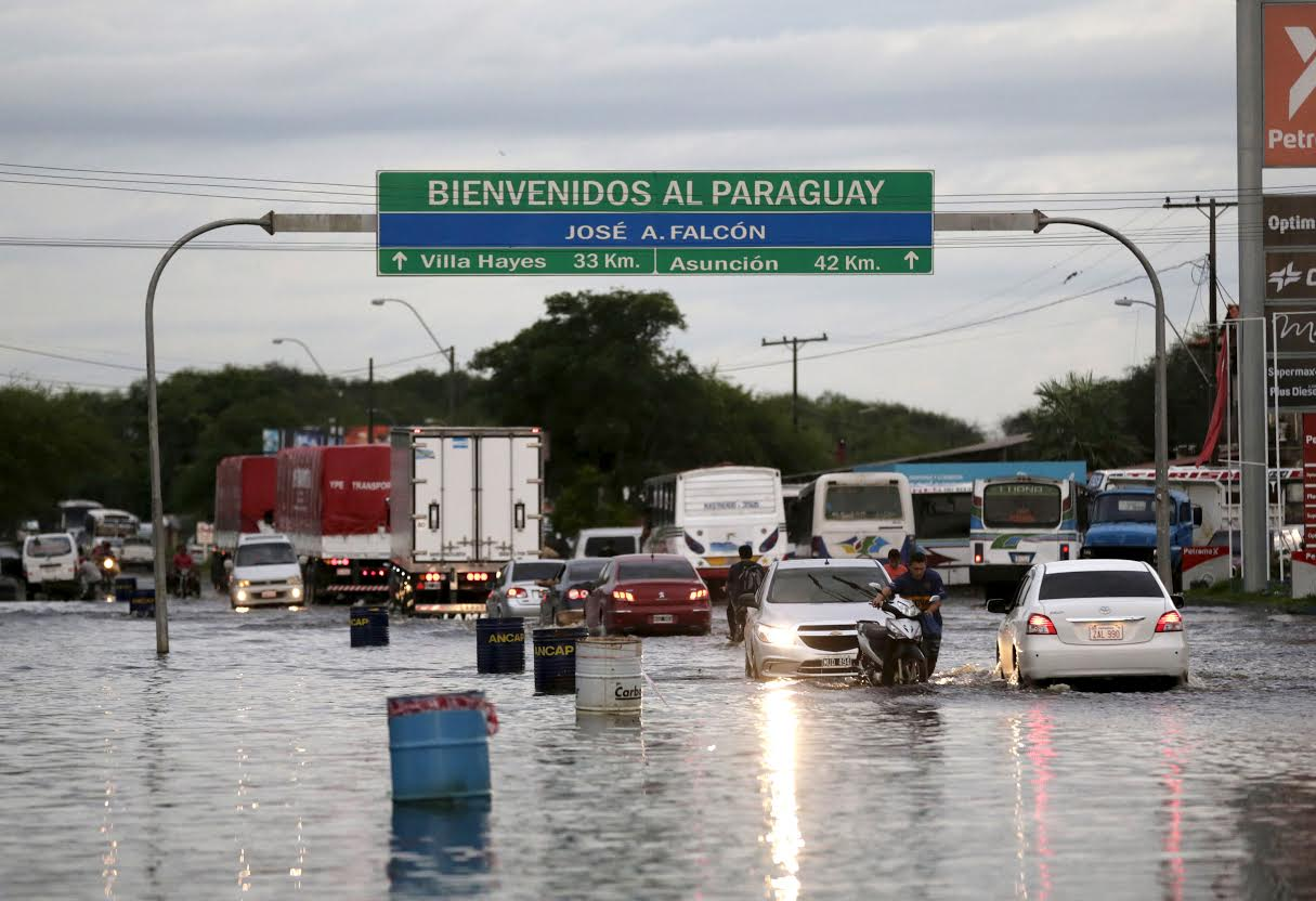 Houses are seen partially submerged in floodwaters in Asuncion, Paraguay